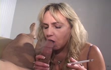 Mature bitch smoking a cigarette and sucking a dick