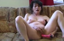 Lonely woman masturbates on the couch