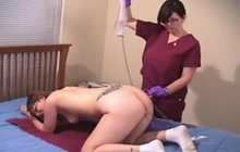 Pleasing woman with enema