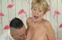 Sexy grandma enjoying hardcore sex with a dude