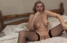Dirty blonde cougar in stockings solo