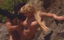 Big boobed blonde screwed on a beach