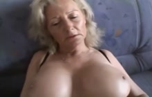Busty blonde woman pleases herself