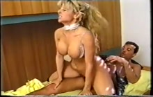 Busty blonde wakes up her hubby with a BJ