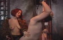 Redhead whore dominates her slave