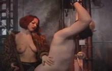 Redhead whore dominates her slave